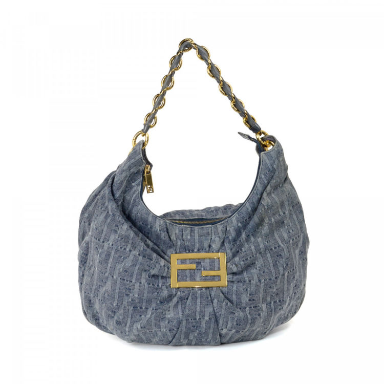 ea66ab3165 The authenticity of this vintage Fendi Mia shoulder bag is guaranteed by  LXRandCo. This beautiful shoulder bag in blue is made in zucca denim.