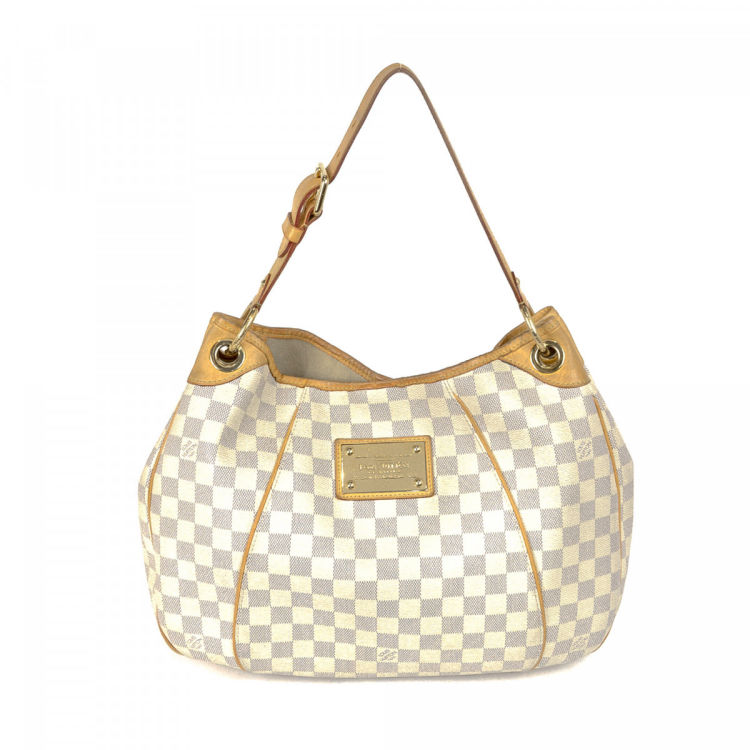cf0bad1163a4 LXRandCo guarantees this is an authentic vintage Louis Vuitton Galliera PM  shoulder bag. This luxurious shoulder bag was crafted in damier azur coated  ...