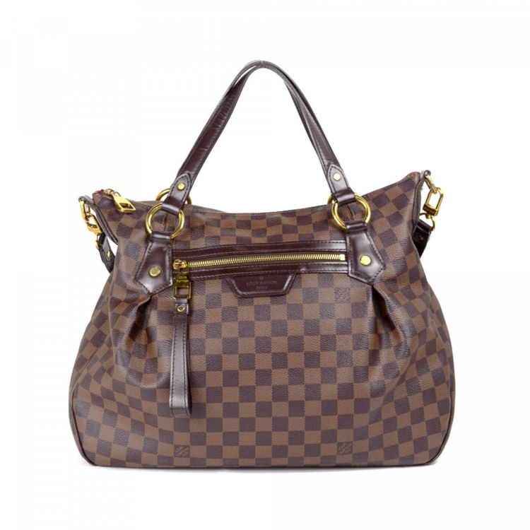 26d69395f7bf LXRandCo guarantees the authenticity of this vintage Louis Vuitton Evora MM  tote. Crafted in damier ebene coated canvas