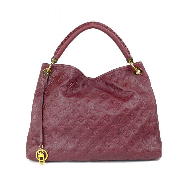 9d404d5132d8 LXRandCo guarantees this is an authentic vintage Louis Vuitton Artsy MM  shoulder bag. This signature bag in aurore is made in monogram empreinte  leather.