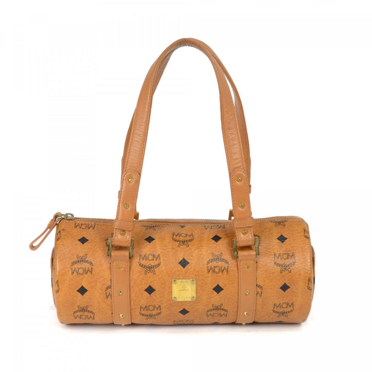 85c12fcb6 The authenticity of this vintage MCM shoulder bag is guaranteed by LXRandCo.  This elegant shoulder bag was crafted in visetos leather in beautiful  cognac.