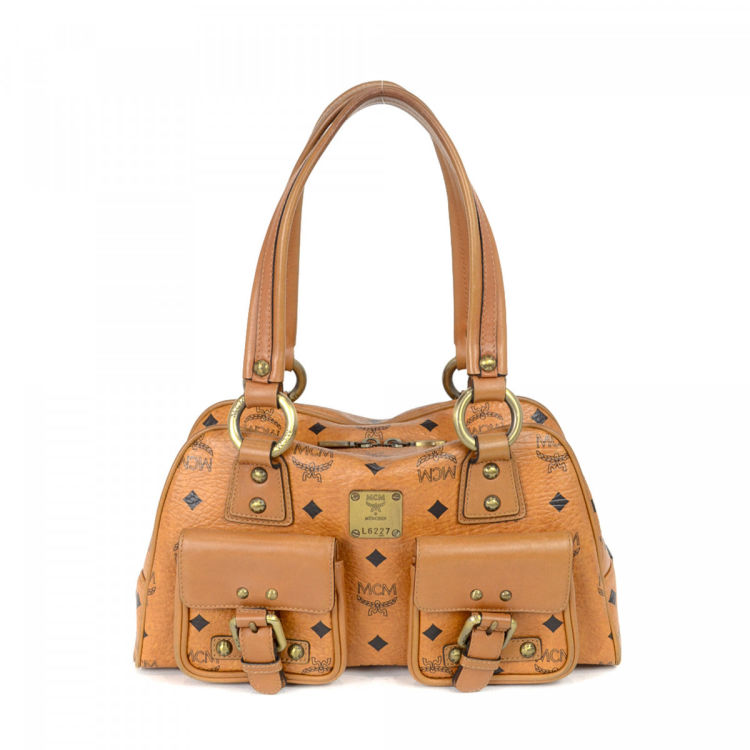 5fb3c03b9 LXRandCo guarantees this is an authentic vintage MCM shoulder bag. Crafted  in visetos leather, this classic shoulder bag comes in beautiful cognac.