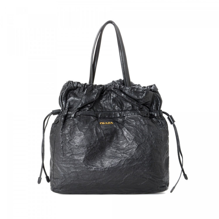 9afd05f321a6 LXRandCo guarantees this is an authentic vintage Prada Bag tote. Crafted in nappa  leather, this elegant work bag comes in black. Due to the vintage nature ...