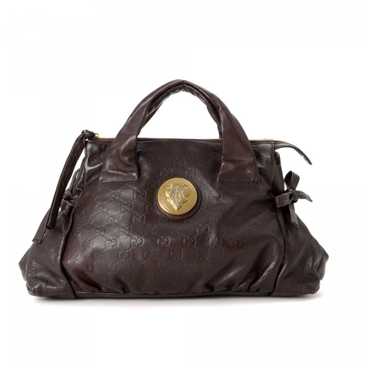 bc2802f4f87 LXRandCo guarantees this is an authentic vintage Gucci Hysteria Crest  handbag. This classic purse in beautiful dark brown is made in guccissima  leather.