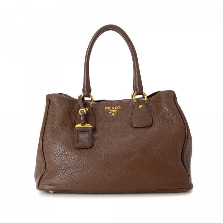 50b043fd8f741 LXRandCo guarantees this is an authentic vintage Prada Vitello Bag tote.  This classic work bag in brown is made in vitello daino leather.