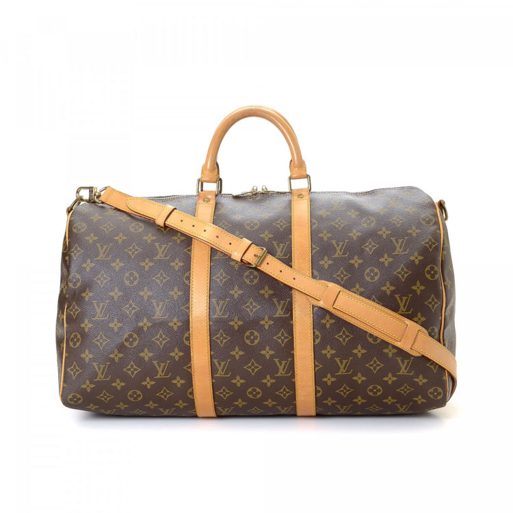 c0f431bc1340c The authenticity of this vintage Louis Vuitton Keepall 50 Bandoulière  travel bag is guaranteed by LXRandCo. This lovely carryall was crafted in  monogram ...