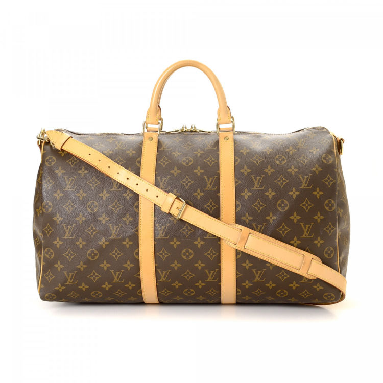 The authenticity of this vintage Louis Vuitton Keepall 50 Bandoulière  travel bag is guaranteed by LXRandCo. Crafted in monogram coated canvas 17977a08e2a81