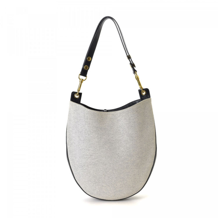 54026a33f2b4 The authenticity of this vintage Céline shoulder bag is guaranteed by  LXRandCo. This refined bag in beautiful grey is made of canvas.