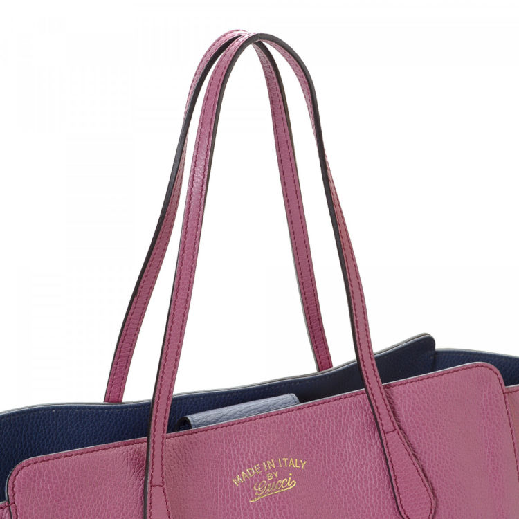 7ddfd79c150c7b The authenticity of this vintage Gucci Swing tote is guaranteed by LXRandCo.  Crafted in leather, this iconic tote comes in purple. Due to the vintage  nature ...