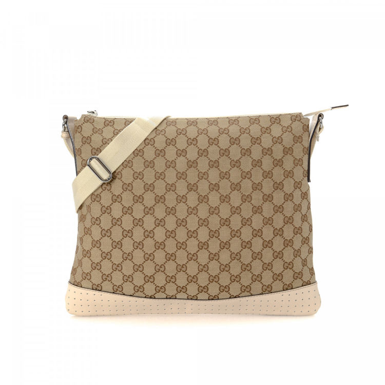 157f7c7a92d LXRandCo guarantees the authenticity of this vintage Gucci Messenger Bag  messenger   crossbody bag. Crafted in gg canvas