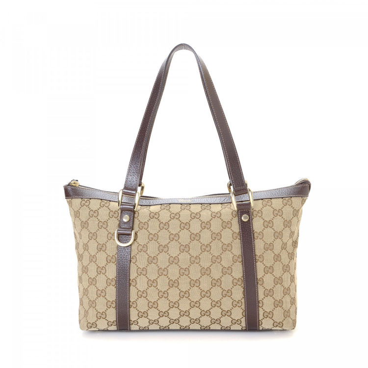 2c6db507e4df LXRandCo guarantees the authenticity of this vintage Gucci Bag tote.  Crafted in gg canvas, this refined work bag comes in beautiful beige.