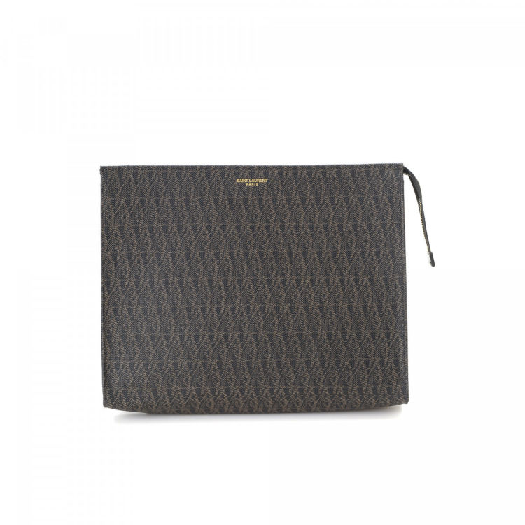 6ec93db7b6c The authenticity of this vintage Yves Saint Laurent clutch is guaranteed by  LXRandCo. This luxurious wristlet was crafted in coated canvas in beautiful  ...