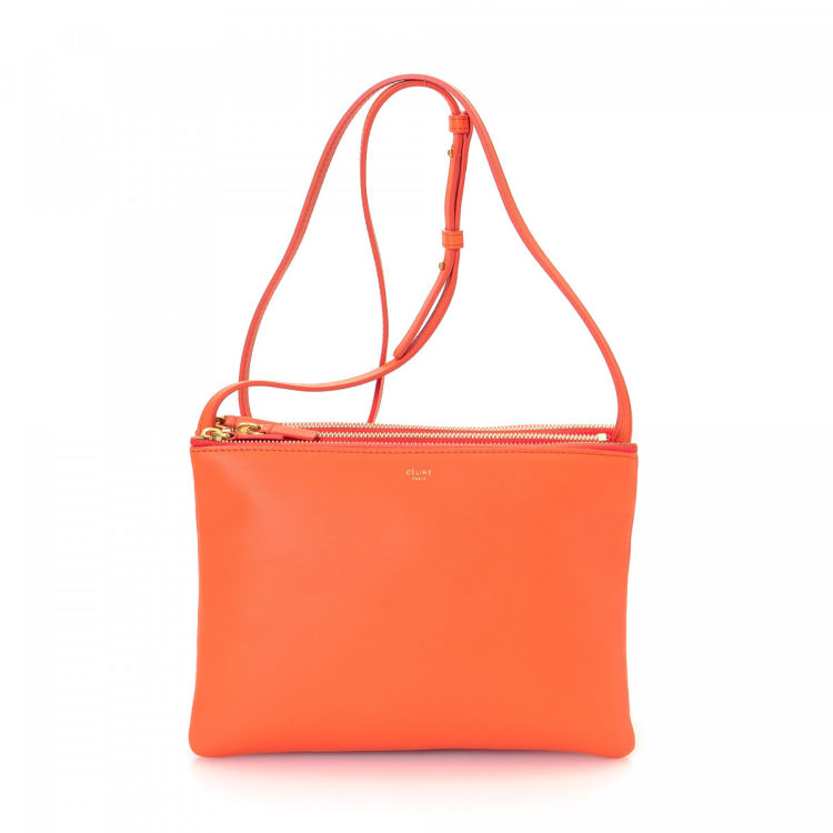 LXRandCo guarantees this is an authentic vintage Céline Trio messenger   crossbody  bag. This lovely messenger   crossbody bag comes in orange leather. 876d725836