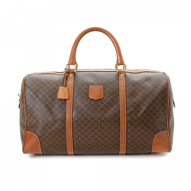 86583e77a312e LXRandCo guarantees the authenticity of this vintage Céline travel bag.  Crafted in macadam coated canvas