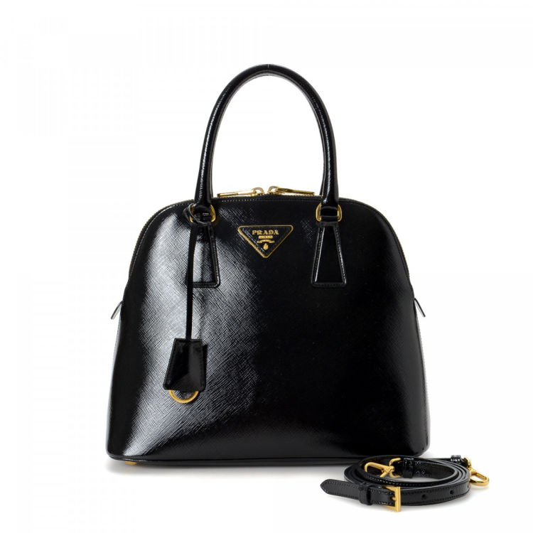 5939edb8f23c LXRandCo guarantees this is an authentic vintage Prada Promenade handbag.  Crafted in saffiano leather