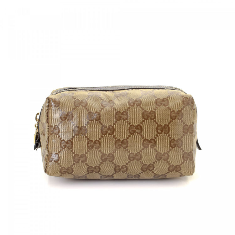 4644bdcecd4 LXRandCo guarantees this is an authentic vintage Gucci Pouch vanity case    pouch. This beautiful cosmetic case in beige is made in gg supreme coated  canvas.