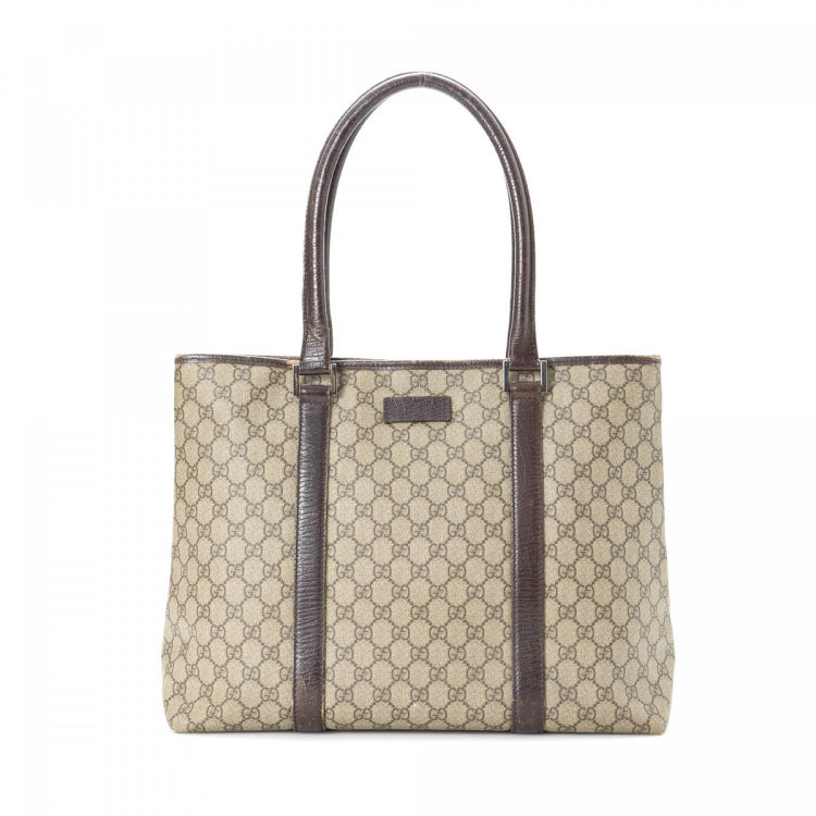 41fa0c7db1b LXRandCo guarantees this is an authentic vintage Gucci Bag tote. This  signature tote bag in beautiful beige is made in gg supreme coated canvas.