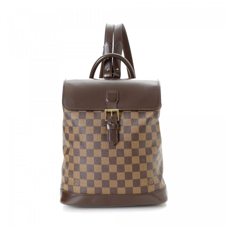 a8dbedbb0596 ... guarantees the authenticity of this vintage Louis Vuitton Soho backpack.  Crafted in damier ebene coated canvas