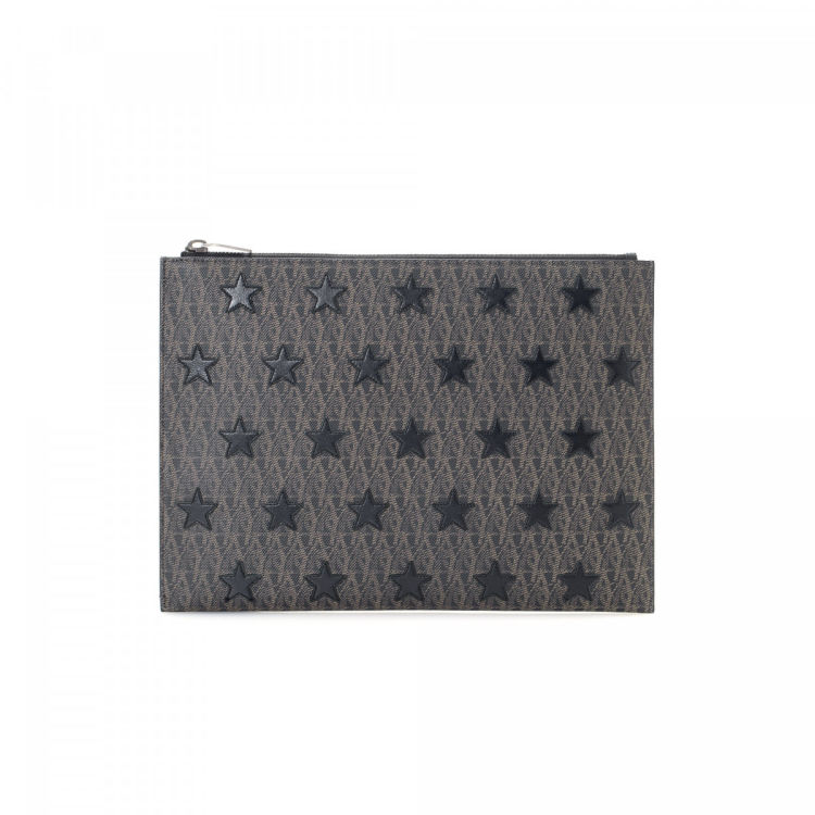 f2314f18e9a LXRandCo guarantees this is an authentic vintage Yves Saint Laurent clutch.  Crafted in coated canvas, this exquisite clutch comes in grey.