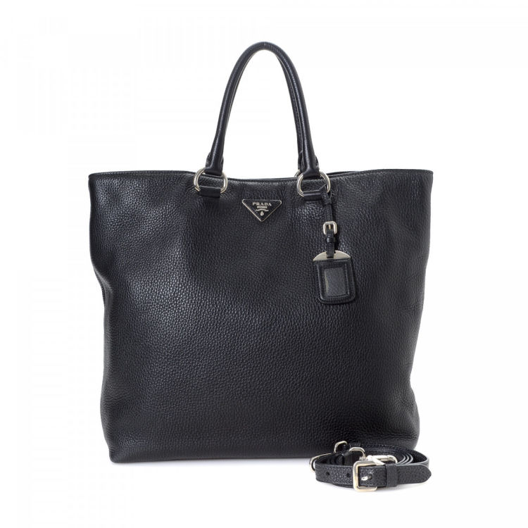 af33d9d7d790 LXRandCo guarantees the authenticity of this vintage Prada Vitello Two Way  tote. Crafted in vitello daino leather, this lovely tote comes in black.