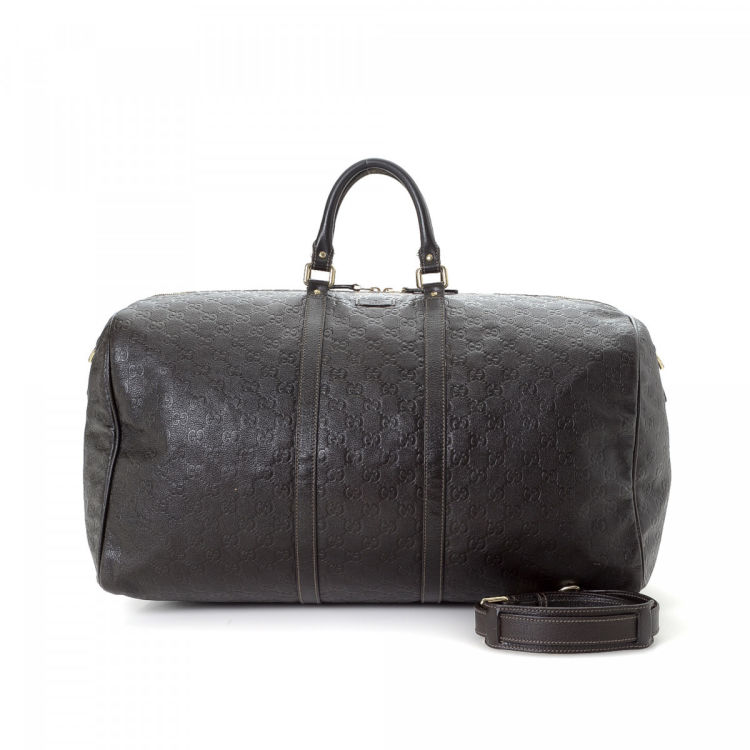 a29ad494ed56 LXRandCo guarantees the authenticity of this vintage Gucci travel bag. This  exquisite carryall was crafted in guccissima leather in beautiful dark  brown.