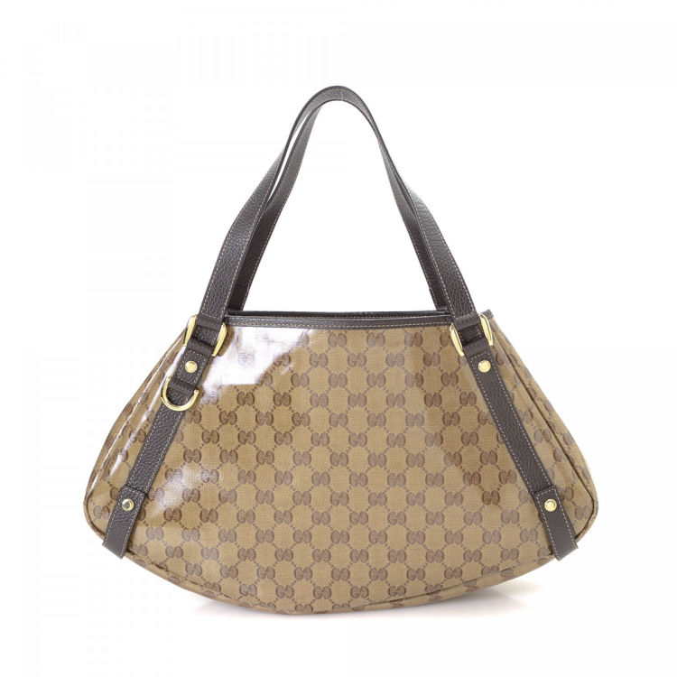 9a62c8ffb990 LXRandCo guarantees the authenticity of this vintage Gucci Abbey tote. This  everyday tote bag in beautiful brown is made in gg crystal coated canvas.