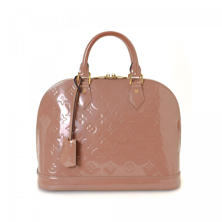 973e7f3a90e2 LXRandCo guarantees the authenticity of this vintage Louis Vuitton Alma PM  handbag. This chic purse was crafted in monogram vernis patent leather in  rose ...