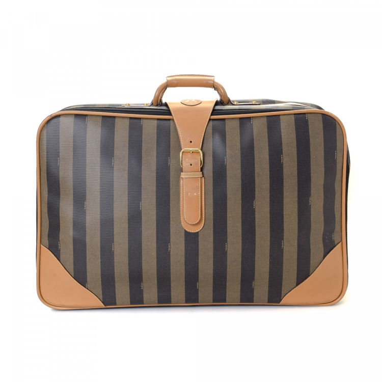 e032a5cacc29 The authenticity of this vintage Fendi travel bag is guaranteed by  LXRandCo. Crafted in pequin coated canvas