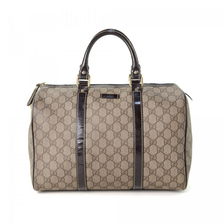 0186983fd2c2e0 LXRandCo guarantees the authenticity of this vintage Gucci Boston Bag  handbag. This practical handbag in brown is made in gg supreme coated  canvas.
