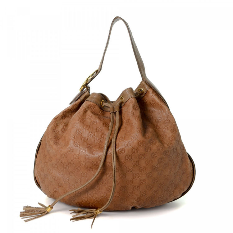 c98870ec7470 LXRandCo guarantees this is an authentic vintage Gucci Tote shoulder bag.  This signature satchel was crafted in guccissima leather in brown.