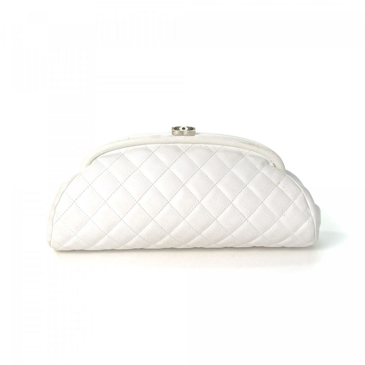 bf727cc65bfa LXRandCo guarantees the authenticity of this vintage Chanel Bag clutch.  This everyday wristlet in white is made in caviar leather. Due to the  vintage nature ...