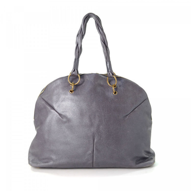 Lxrandco Guarantees This Is An Authentic Vintage Yves Saint Laurent Calypso Handbag Luxurious In Beautiful Metallic Grey Made Of Leather