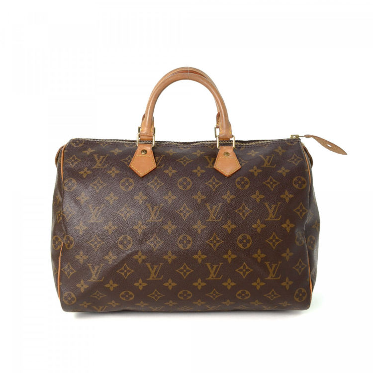 ab0d296ec12a LXRandCo guarantees this is an authentic vintage Louis Vuitton Speedy 35  handbag. This sophisticated bag was crafted in monogram coated canvas in  beautiful ...