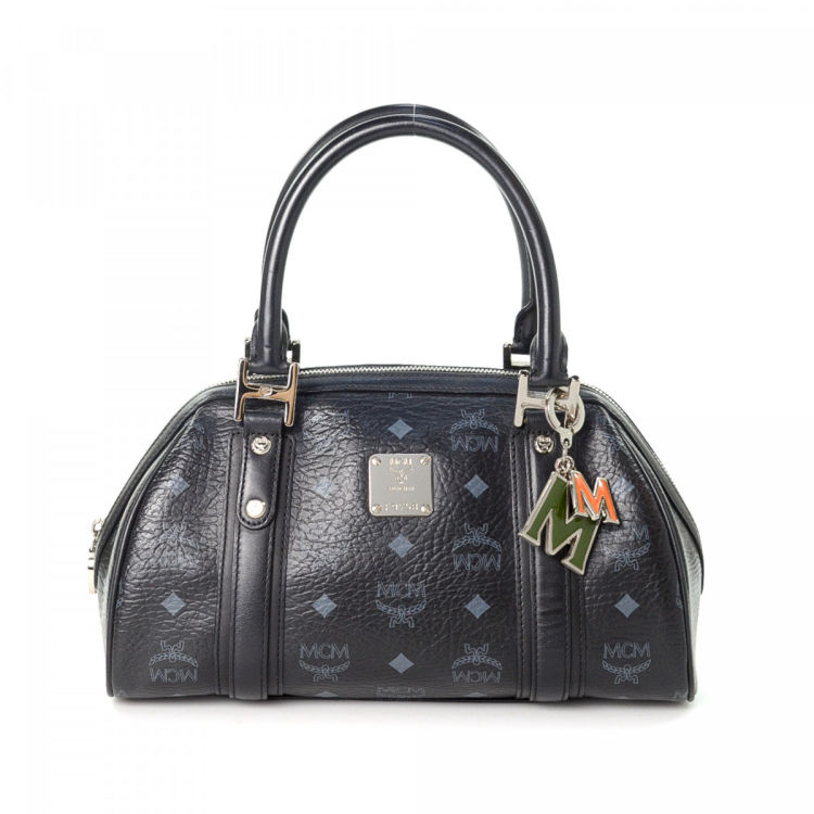 The Authenticity Of This Vintage Mcm Handbag Is Guaranteed By Lxrandco Crafted In Visetos Leather Sophisticated Purse Comes Black