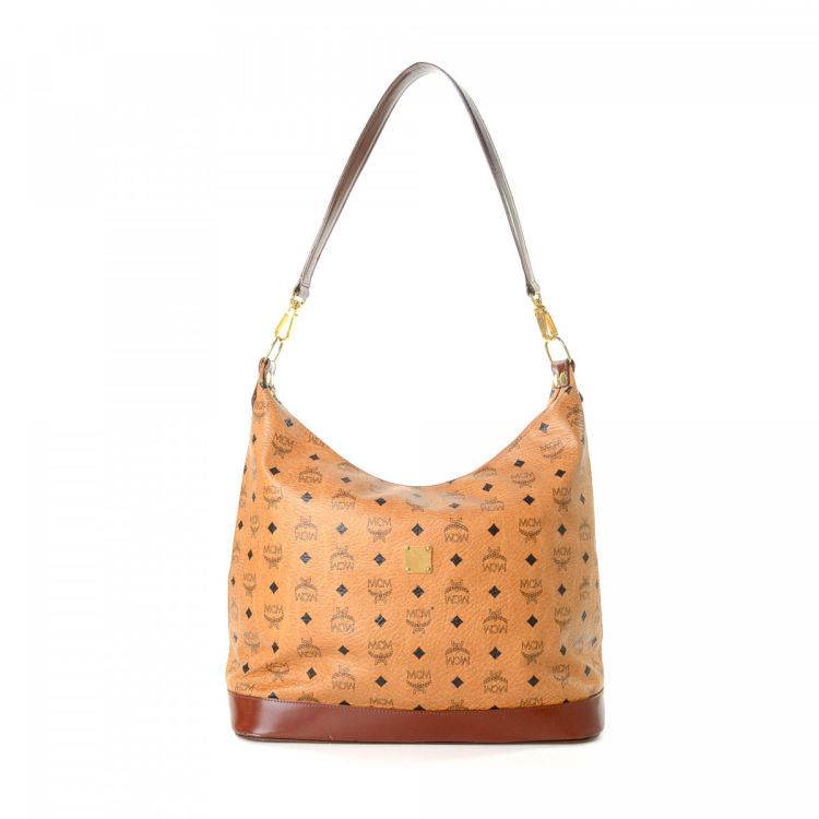 1a0fd4a96 The authenticity of this vintage MCM Hobo Bag shoulder bag is guaranteed by  LXRandCo. Crafted in visetos leather, this classic purse comes in cognac.