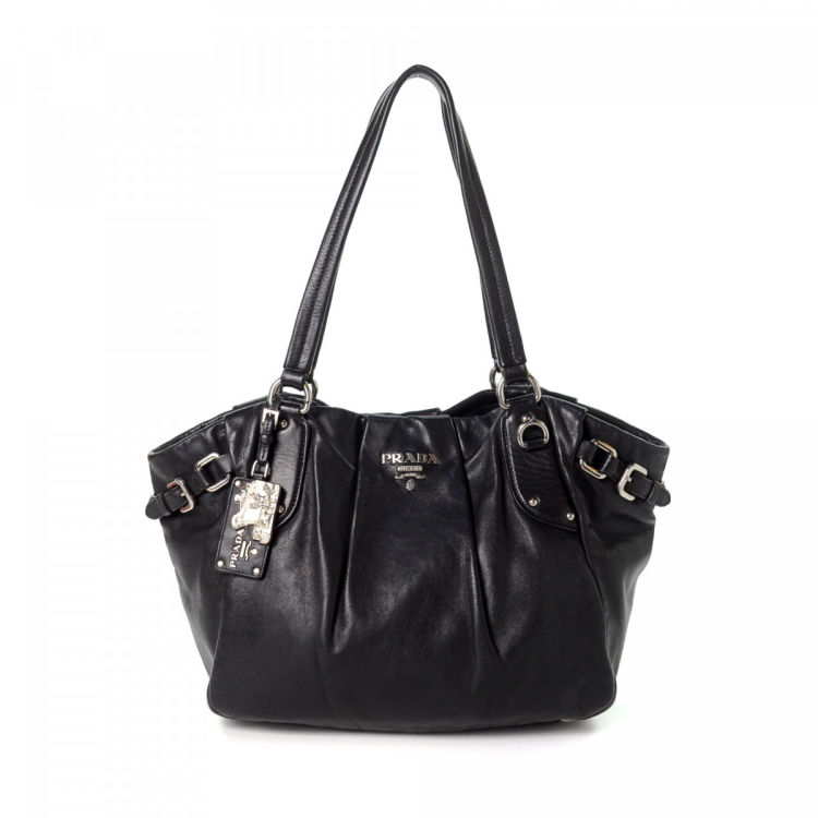 e7e3768d5f8a The authenticity of this vintage Prada Nappa tote is guaranteed by LXRandCo.  Crafted in leather, this chic tote comes in black. Due to the vintage  nature of ...
