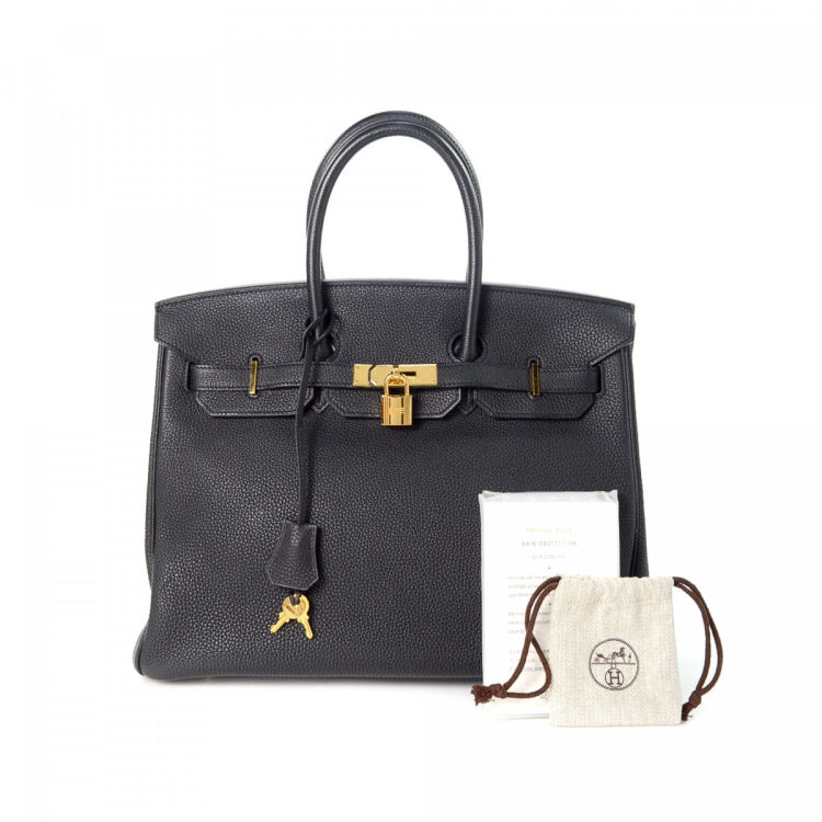 89a7317efaf1 The authenticity of this vintage Hermès Birkin 35 handbag is guaranteed by  LXRandCo. This everyday bag was crafted in calf in beautiful black.