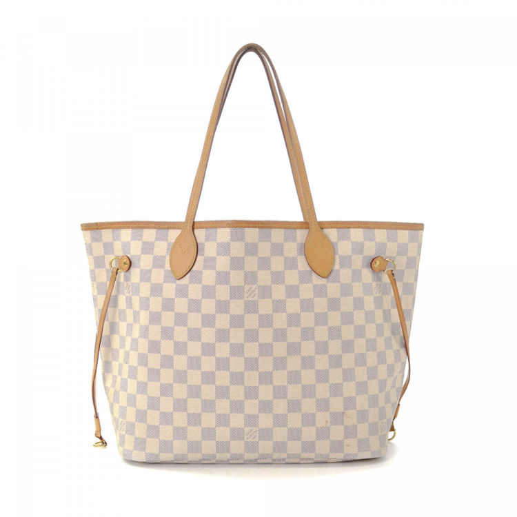 df7ab0a6b327 The authenticity of this vintage Louis Vuitton Neverfull MM tote is  guaranteed by LXRandCo. This classic work bag in white is made in damier  azur coated ...