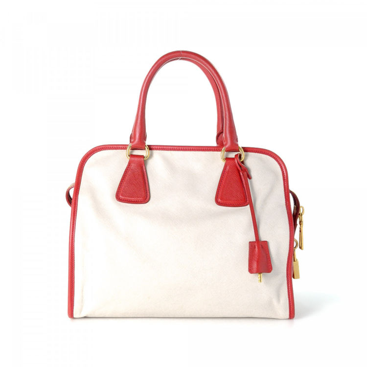 e34850288283 The authenticity of this vintage Prada Two Way Bag handbag is guaranteed by  LXRandCo. This lovely purse was crafted in saffiano leather in two-tone.