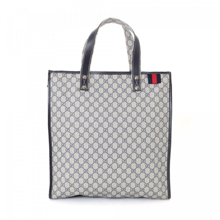423dfc85df6 LXRandCo guarantees this is an authentic vintage Gucci tote. This elegant  work bag in blue is made in gg supreme coated canvas. Due to the vintage  nature of ...