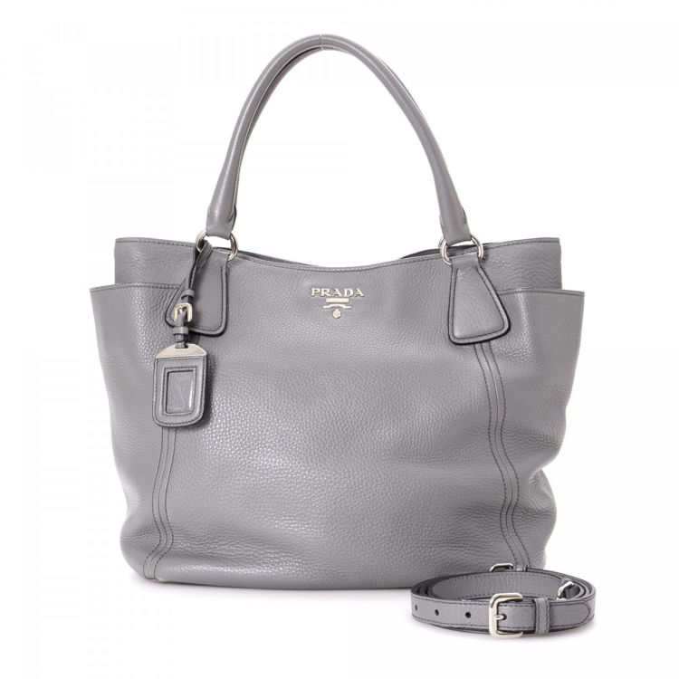 7d2b30fd24ef LXRandCo guarantees this is an authentic vintage Prada Two Way tote.  Crafted in leather, this exquisite work bag comes in grey. Very good  condition* (A)
