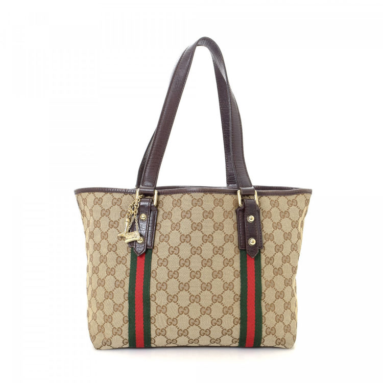 fb8a7e0b4cf LXRandCo guarantees the authenticity of this vintage Gucci Jolicoeur Web  tote. Crafted in gg canvas
