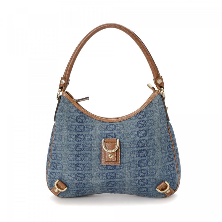 8f260107fcf LXRandCo guarantees the authenticity of this vintage Gucci Abbey shoulder  bag. Crafted in canvas