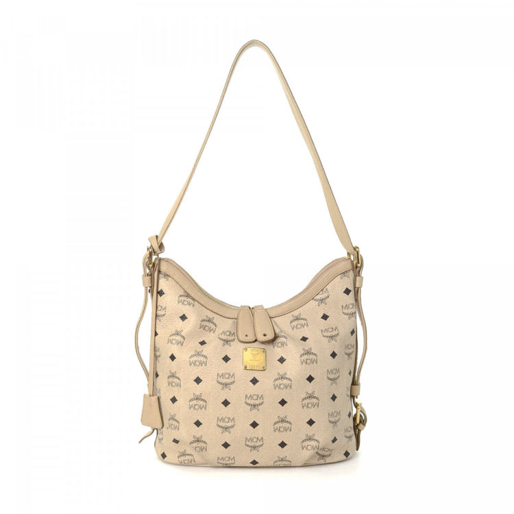575f2ff3d LXRandCo guarantees this is an authentic vintage MCM shoulder bag. This  exquisite shoulder bag was crafted in visetos leather in beige.