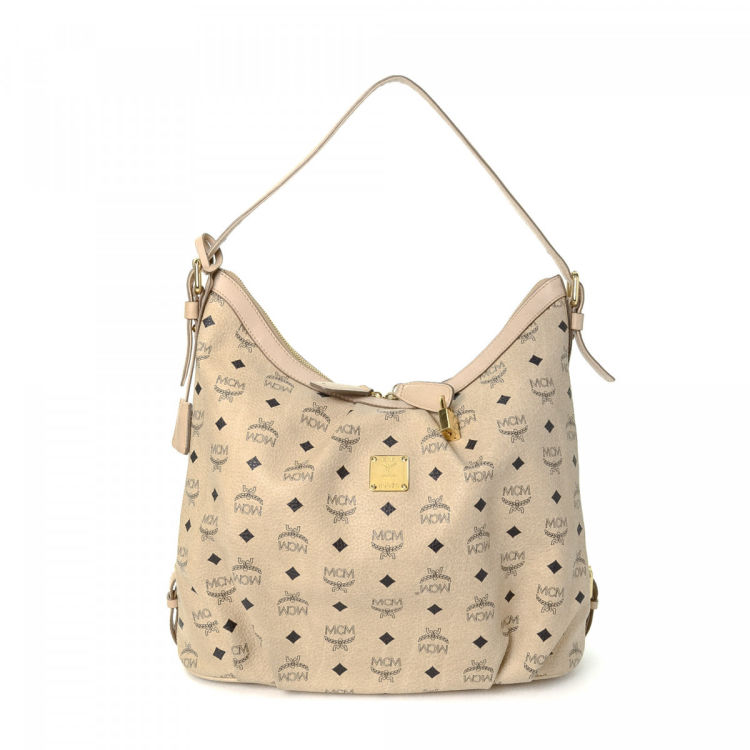 cad64cc12 LXRandCo guarantees the authenticity of this vintage MCM shoulder bag.  Crafted in visetos leather, this exquisite shoulder bag comes in beige.