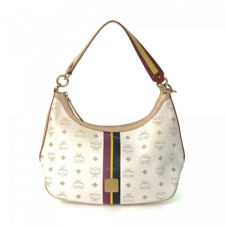 17b885a1a0 The authenticity of this vintage MCM shoulder bag is guaranteed by  LXRandCo. This iconic satchel was crafted in visetos leather in white.