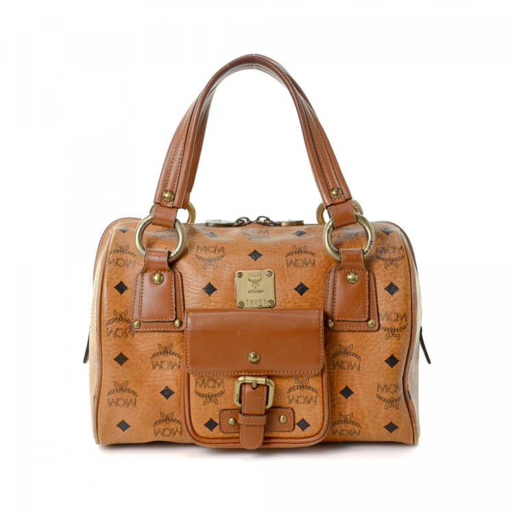 8d3711894 LXRandCo guarantees this is an authentic vintage MCM Boston Bag handbag.  This lovely bag in beautiful cognac is made in visetos leather.