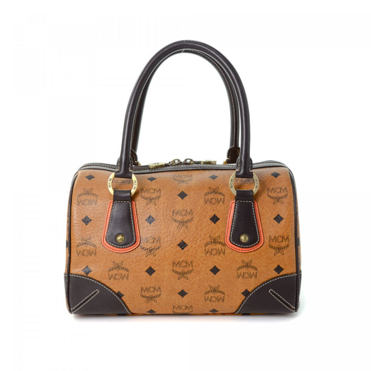 7cb4e137e The authenticity of this vintage MCM Boston Bag handbag is guaranteed by  LXRandCo. Crafted in visetos leather, this luxurious bag comes in cognac.