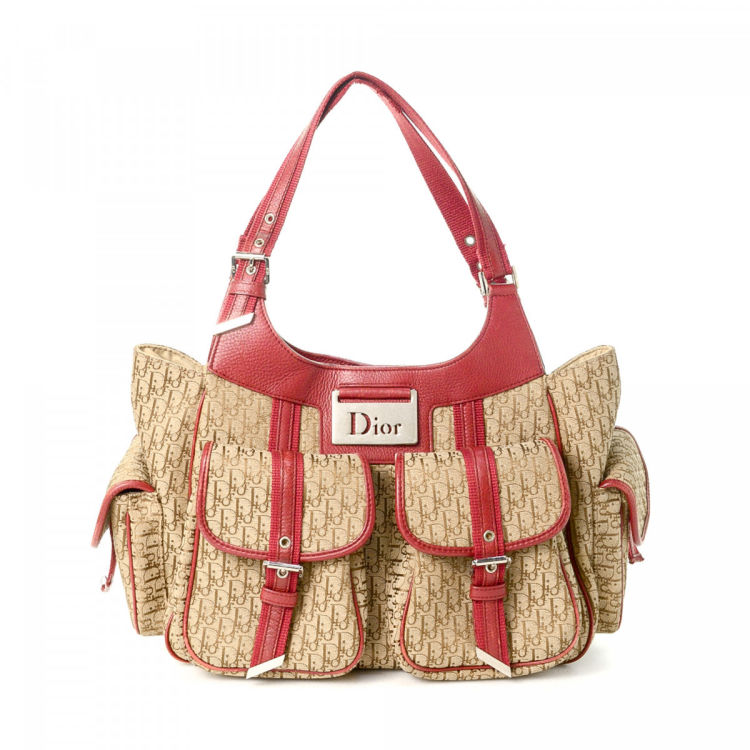 14f2c6a6a793 LXRandCo guarantees the authenticity of this vintage Dior handbag. Crafted  in trotteur canvas