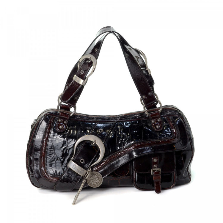 LXRandCo guarantees this is an authentic vintage Dior Gaucho Double Saddle  Bag shoulder bag. This luxurious purse comes in bordeaux patent leather. d2b5622638fad